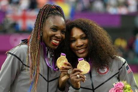Venus (left) and Serena Williams with their gold medals in London.